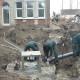 Plaatsen van riolering bij landhuis